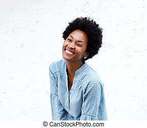 Cute young black woman looking away and smiling