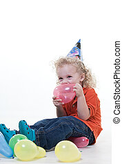 Cute young blond toddler jewish boy playing