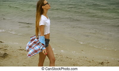 cute young blonde on a seashore