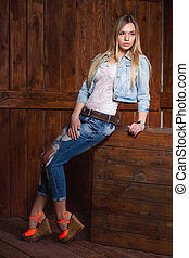 Cute young blonde posing in the studio.