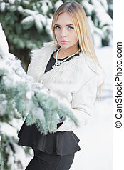Cute young blonde posing in winter