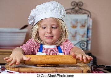 Cute young boy baking
