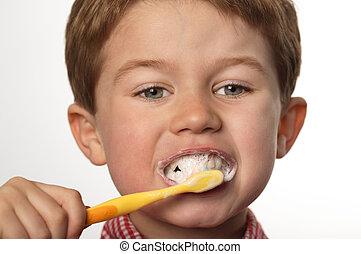 young boy brushing teeth
