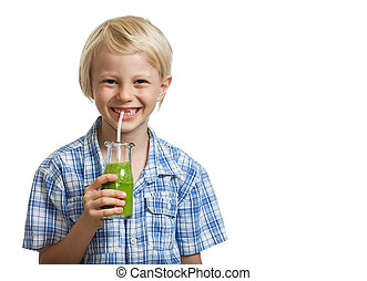 Cute young boy drinking green smoothie