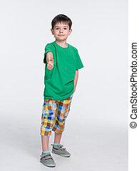 Cute young boy in a green shirt