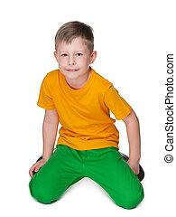 Cute young boy in a yellow shirt