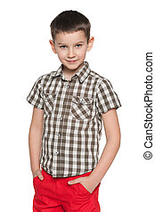 Cute young boy on the white background