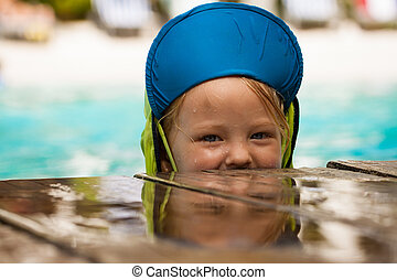 Cute young boy playing in water