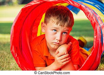 Cute Young Boy Playing