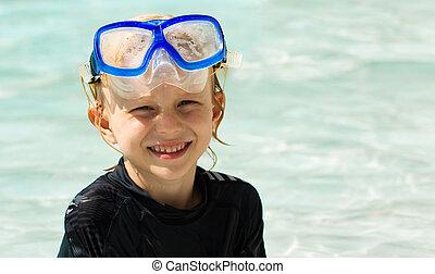 Cute young boy wearing mask