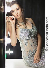 Cute young brunette posing in a studio.