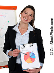 cute young businesswoman showing pie chart during meeting