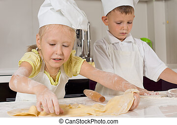 Cute Young Chefs Busy Preparing Food