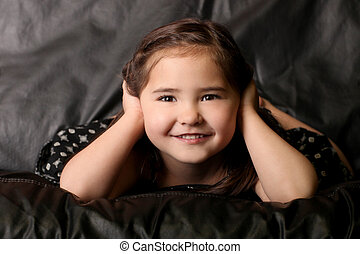 Cute Young Child Covering Her Ears