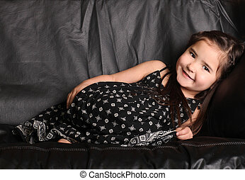 Cute Young Child Lying on a Couch