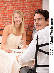 cute young couple at restaurant