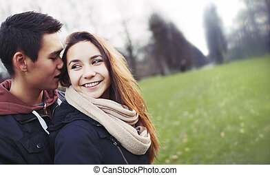 Cute young couple sharing beautiful time on park