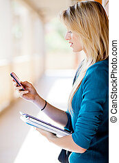 college student using smart phone browsing internet