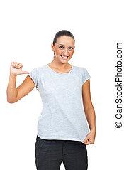 Cute young female showing t-shirt