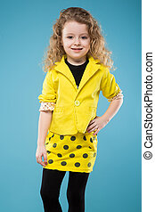 Cute young girl dressed all in yellow