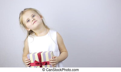 Cute young girl holding a gift