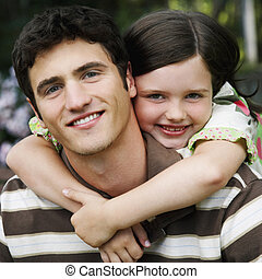 Cute Young Girl Hugging Young Man - Young girl wraps her...