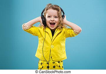 Cute young girl in earphones