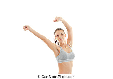 cute young girl in grey top with a beautiful belly raised two hands up