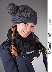 Cute young girl in winter hat