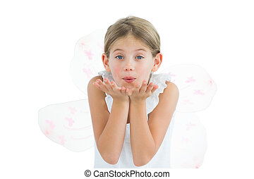 Cute young girl sending kiss to camera while posing on white...