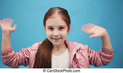 cute young girl waves her hands - pretty young girl waves...