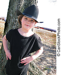 Cute young girl wearing black hat