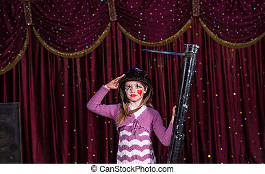 Cute young girl with a blunderbuss
