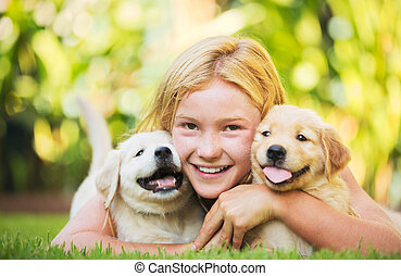 Cute Young Girl with Puppies - Adorable Cute Young Girl...