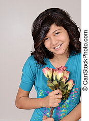 cute young girl with roses