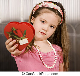 Cute young girl with Valentine