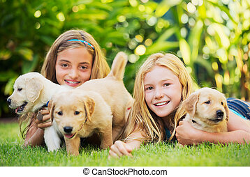 Cute Young Girls with Puppies