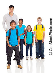 young indian boy in front of classmates and teacher - cute...