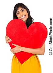 young indian woman holding red heart