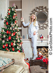 Cute young lady dressed in pajamas