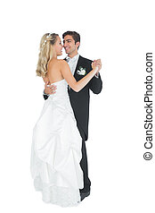 Cute young married couple dancing Viennese waltz on white...