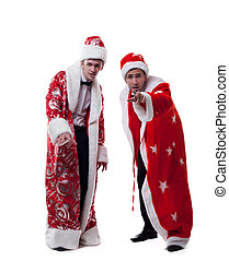 Cute young people posing dressed as Santa Claus