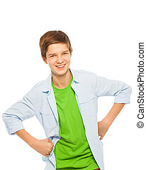 Cute young teen boy smiling with hands on waist