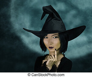 Cute young witch - Portrait of beautiful young witch on full...