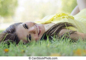Cute young woman at the park