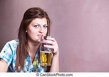 young woman drinking lager