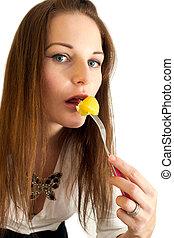 Cute young woman eating a potatoe
