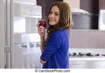 Cute young woman eating healthy