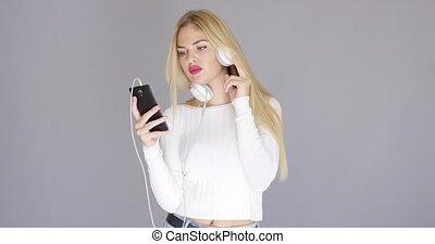 Cute young woman enjoying her music