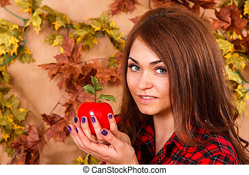 Cute young woman holding an apple